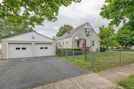 Single Family Home Sold in Stratford CT 06614.  cape cod house near beach side waterfront with 2 car garage.