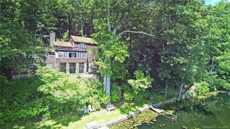 Single Family Home Sold in Ridgefield CT 06877. Old  cottage house near beach side waterfront with 2 car garage.