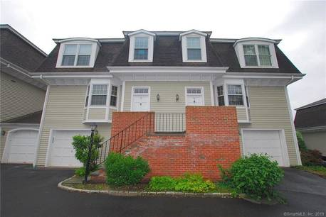 Condo Home For Sale in Greenwich CT 06830.  townhouse near beach side waterfront with 1 car garage.