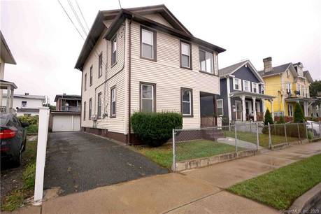 Multi Family Home Sold in Bridgeport CT 06608. Old  house near waterfront with 5 car garage.