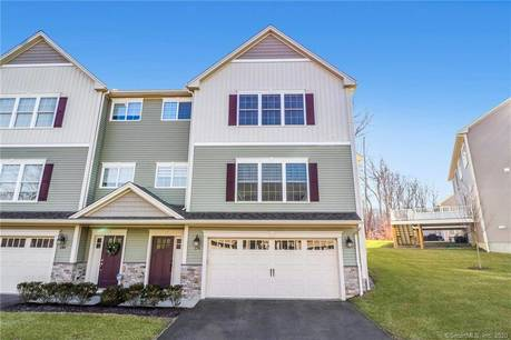 Condo Home For Sale in Shelton CT 06484.  townhouse near waterfront with swimming pool and 2 car garage.