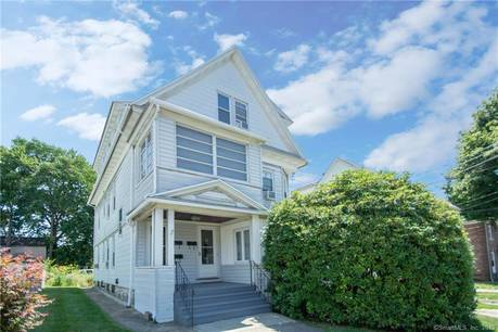 Multi Family Home Sold in Bridgeport CT 06606. Old  house near beach side waterfront with 3 car garage.