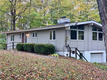 Single Family Home Sold in Ridgefield CT 06877. Contemporary, ranch house near beach side waterfront with 1 car garage.
