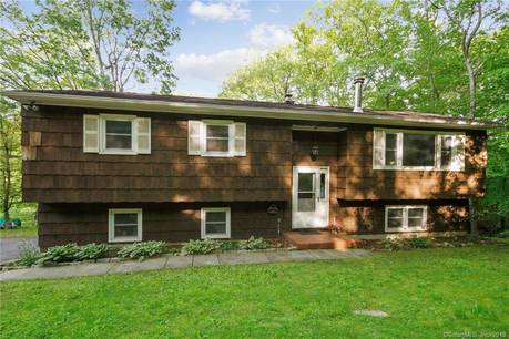 Single Family Home Sold in New Fairfield CT 06812. Ranch house near river side waterfront with 2 car garage.