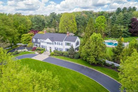 Single Family Home Sold in Wilton CT 06897. Colonial, georgian house near lake side waterfront with swimming pool and 2 car garage.