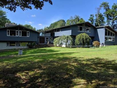 Single Family Home Sold in Brookfield CT 06804. Contemporary house near waterfront with swimming pool and 2 car garage.