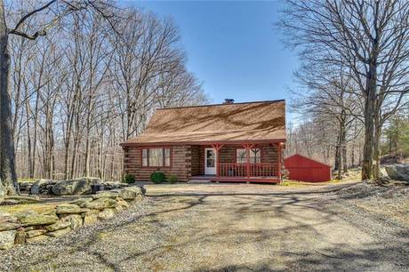 Single Family Home For Sale in Shelton CT 06464. Ranch house near waterfront.