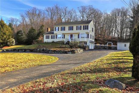 Single Family Home For Sale in Monroe CT 06468. Colonial house near waterfront with 2 car garage.