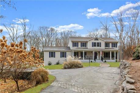 Single Family Home For Sale in Wilton CT 06897. Colonial house near waterfront with swimming pool and 2 car garage.