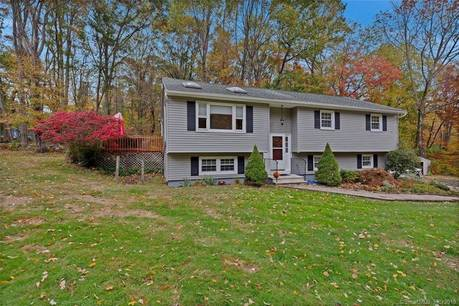 Single Family Home For Sale in New Fairfield CT 06812. Ranch house near waterfront with 2 car garage.