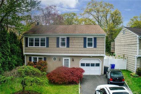 Single Family Home Sold in Norwalk CT 06854. Ranch house near river side waterfront with 1 car garage.