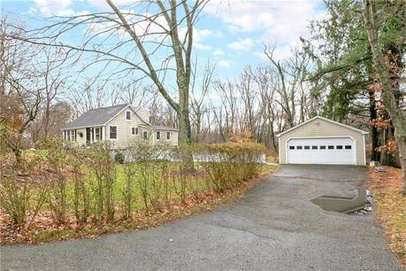Single Family Home For Sale in Shelton CT 06484.  cape cod, cottage house near waterfront with 2 car garage.