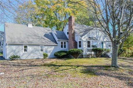 Single Family Home For Sale in Trumbull CT 06611.  cape cod house near waterfront with 2 car garage.