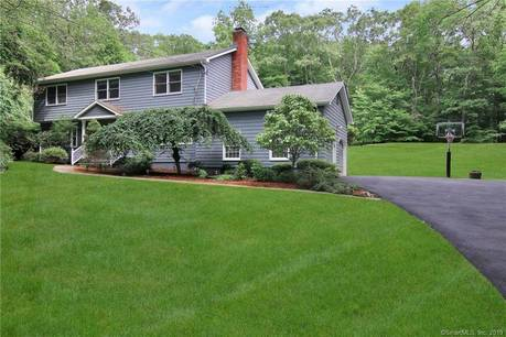 Single Family Home Sold in Weston CT 06883. Colonial house near waterfront with swimming pool and 2 car garage.
