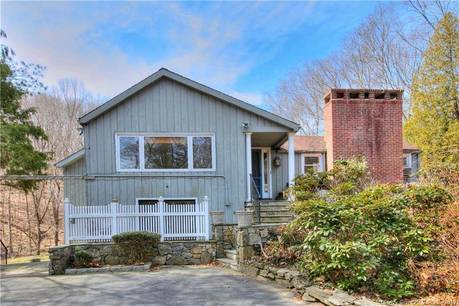 Single Family Home Sold in Weston CT 06883. Contemporary chalet house near river side waterfront with swimming pool and 1 car garage.