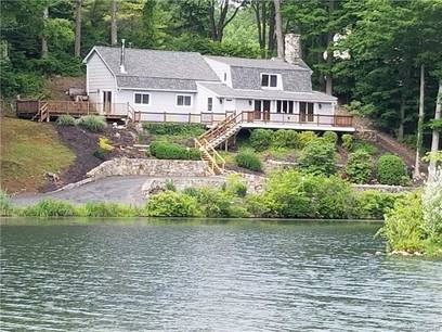 Single Family Home Sold in Ridgefield CT 06877.  cape cod house near beach side waterfront.
