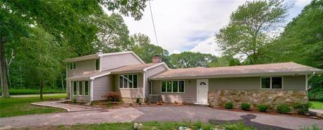 Single Family Home Sold in Stratford CT 06614. Contemporary house near waterfront with 2 car garage.