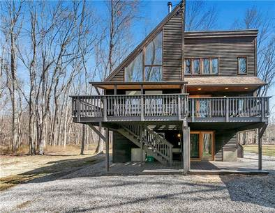 Single Family Home For Sale in Newtown CT 06470. Contemporary house near waterfront.