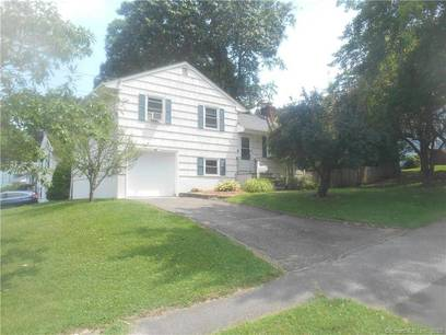 Single Family Home Sold in Norwalk CT 06850.  house near waterfront with swimming pool and 1 car garage.
