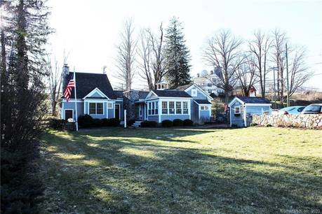Single Family Home For Sale in Sherman CT 06784. Old antique cape cod house near river side waterfront with 1 car garage.