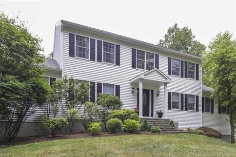 Single Family Home For Sale in New Fairfield CT 06812. Colonial house near waterfront with 3 car garage.