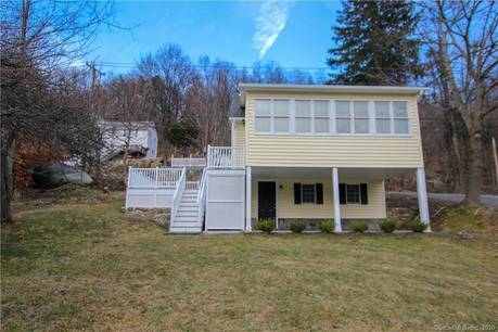 Single Family Home For Sale in New Fairfield CT 06812.  bungalow house near waterfront.