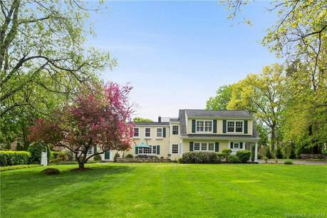 Single Family Home Sold in Darien CT 06820. Old colonial house near beach side waterfront with swimming pool and 2 car garage.