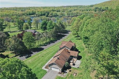 Single Family Home Sold in Danbury CT 06811. Ranch, colonial house near lake side waterfront with 2 car garage.