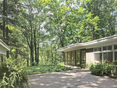 Single Family Home Sold in Wilton CT 06897. Contemporary, ranch house near waterfront with 2 car garage.