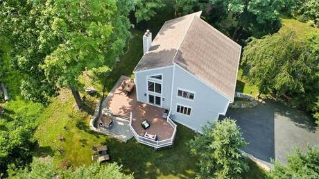 Single Family Home Sold in Westport CT 06880. Contemporary house near beach side waterfront with 2 car garage.