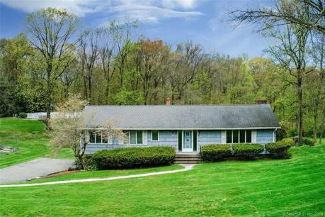 Single Family Home Sold in Trumbull CT 06611. Ranch house near river side waterfront with swimming pool and 2 car garage.