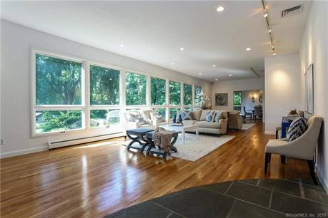 Single Family Home Sold in Greenwich CT 06831. Contemporary house near waterfront with swimming pool and 2 car garage.