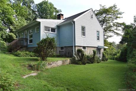 Single Family Home Sold in Westport CT 06880. Old ranch house near beach side waterfront with 2 car garage.