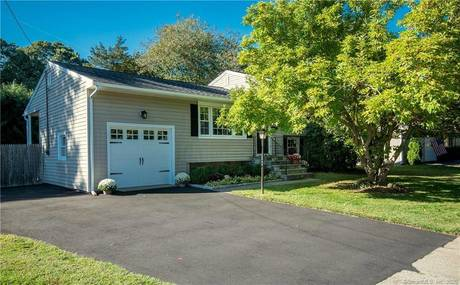Single Family Home Sold in Fairfield CT 06824.  house near waterfront with 1 car garage.