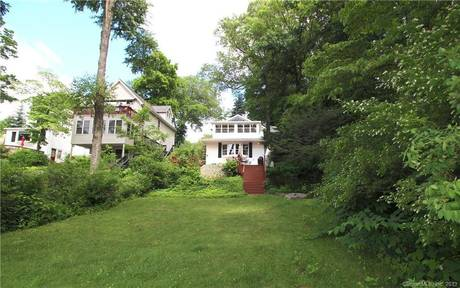Single Family Home Sold in Danbury CT 06811. Old  chalet house near lake side waterfront with 2 car garage.