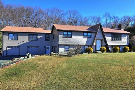 Single Family Home Sold in Shelton CT 06484. Ranch house near river side waterfront with 4 car garage.