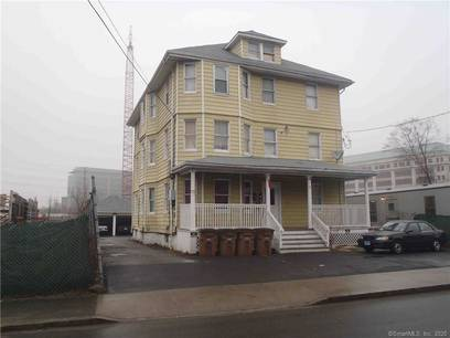 Multi Family Home For Sale in Stamford CT 06902. Old  house near waterfront with 2 car garage.