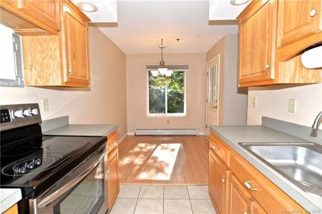 Condo Home For Sale in Brookfield CT 06804. Ranch house near waterfront with swimming pool.