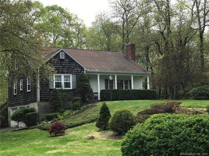 Single Family Home For Sale in Ridgefield CT 06877.  cape cod house near waterfront with 2 car garage.