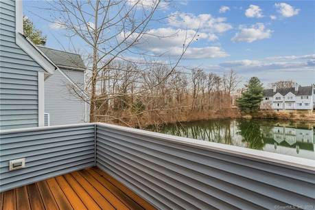 Condo Home Sold in Wilton CT 06897.  townhouse near lake side waterfront with swimming pool and 1 car garage.
