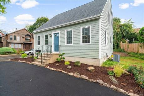 Single Family Home For Sale in Bridgeport CT 06605.  cape cod house near waterfront.