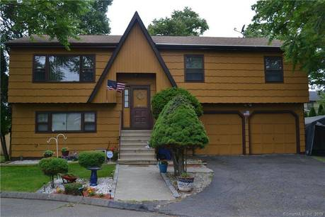 Single Family Home Sold in Bridgeport CT 06606. Ranch house near beach side waterfront with 2 car garage.