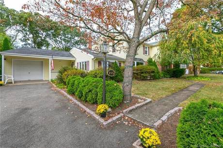 Single Family Home Sold in Stratford CT 06614. Colonial house near beach side waterfront with swimming pool and 1 car garage.