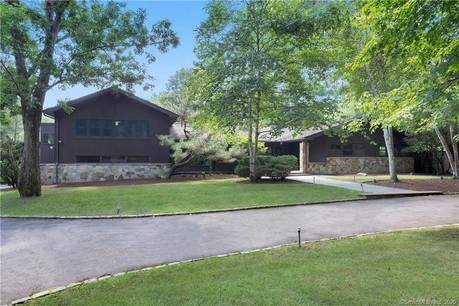 Single Family Home Sold in Greenwich CT 06831. Ranch house near lake side waterfront with swimming pool and 2 car garage.