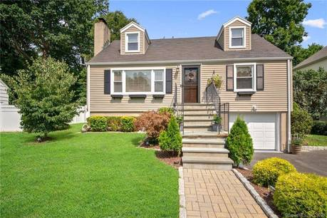 Single Family Home Sold in Norwalk CT 06854.  cape cod house near waterfront with swimming pool and 1 car garage.