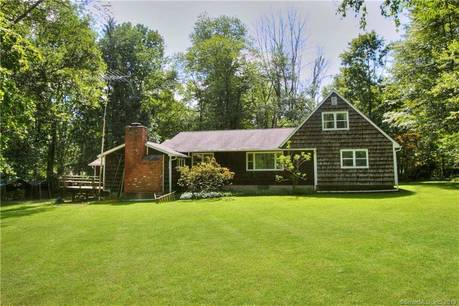 Single Family Home Sold in Redding CT 06896.  cape cod house near waterfront with 2 car garage.