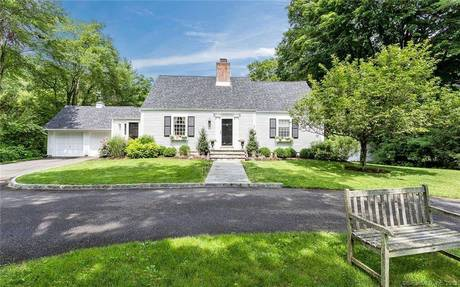 Single Family Home Sold in Wilton CT 06897.  cape cod house near waterfront with 2 car garage.