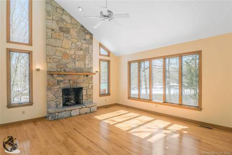 Single Family Home Sold in Greenwich CT 06831. Contemporary, colonial house near lake side waterfront with 2 car garage.