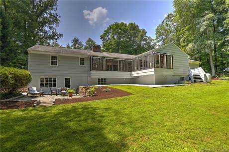 Single Family Home Sold in Westport CT 06880. Ranch house near beach side waterfront with 4 car garage.