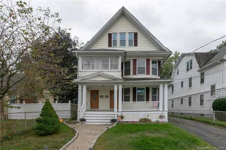 Multi Family Home Sold in Bridgeport CT 06610. Old  house near waterfront with 2 car garage.
